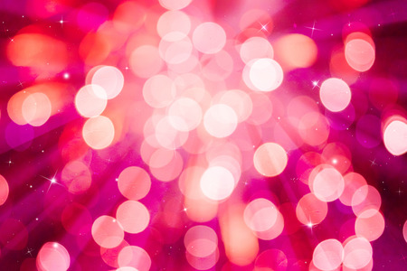 ray of lights: Pink ray lights bokeh glitter defocused abstract background holiiday.
