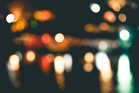 ray of lights: Night in city ray lights bokeh glitter defocused abstract background vintage or retro color tone.