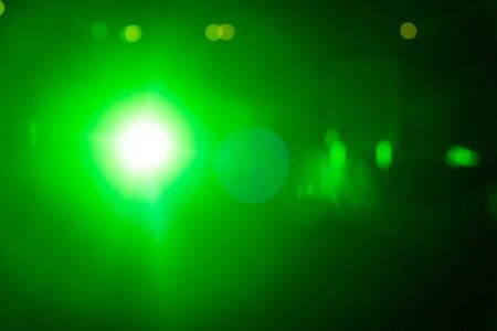 ray of lights: Green ray lights bokeh glitter defocused  abstract background Stock Photo