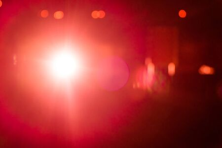 ray of lights: Red ray lights bokeh glitter defocused; abstract background