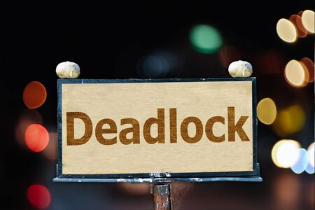 deadlock: Deadlock old board with bokeh background. Stock Photo