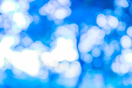 blue ray: Blue ray bokeh glitter defocused lights abstract background Stock Photo
