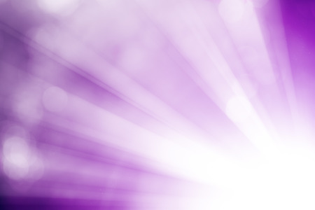 light ray: Purple glitter sparkle defocused rays lights bokeh abstract background.