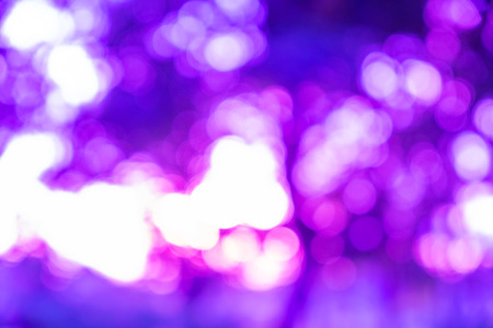 purple abstract background: Purple ray bokeh glitter defocused lights abstract background Stock Photo