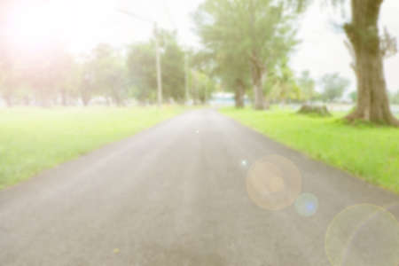 bigger picture: Blurred background of road way and tree.vintage tone.