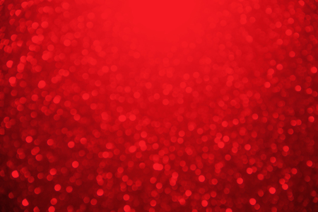 glitter: Red glitter sparkle defocused rays lights bokeh abstract background. Stock Photo