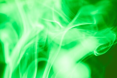 fervent: Green smoke abstract dark background Stock Photo