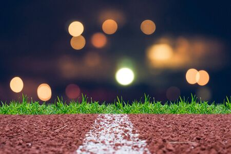 sprightly: Running track with night glitter rays lights bokeh business background.