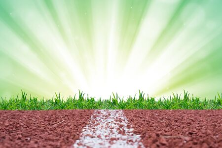 sprightly: Running track with green glitter rays lights bokeh business background.