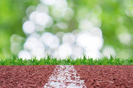 sprightly: Running track with natural glitter rays lights bokeh business background.