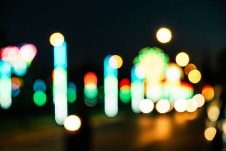 city lights: Night in city festival ray lights bokeh glitter defocused abstract background vintage color tone.