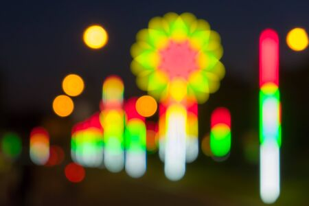 city lights: Night in city festival ray lights bokeh glitter defocused abstract background.