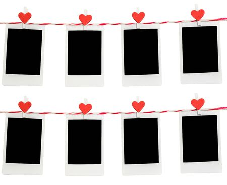 pack string: 8 Blank instant photo and red clip paper heart hanging on the clothesline with white background.Designer concept.