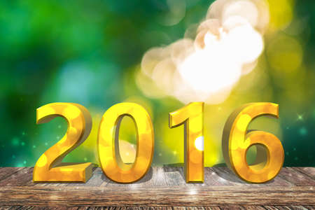2016 new year on wooden table with green nature bokeh background. Stock Photo