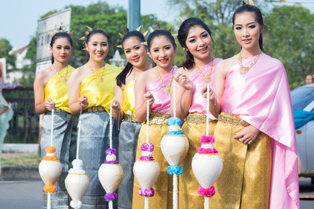 rousing: AYUTTHAYA, THAILAND - DEC 18, 2015 :Festival Thai traditional parade,Beautiful girl and Handsome boy walk around in Ayutthaya city,december 18,2015 in Ayutthaya Province,Thailand. Editorial