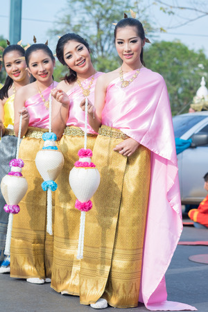 rousing: AYUTTHAYA, THAILAND - DEC 18, 2015 :Festival Thai traditional parade,Beautiful girl and Handsome boy walk around in Ayutthaya city,december 18,2015 in Ayutthaya Province,Thailand. Editorial