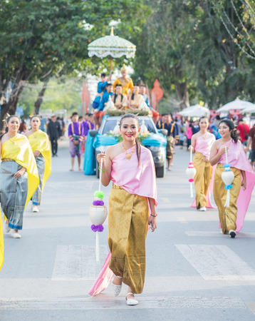 provoking: AYUTTHAYA, THAILAND - DEC 18, 2015 :Festival Thai traditional parade,Beautiful girl and Handsome boy walk around in Ayutthaya city,december 18,2015 in Ayutthaya Province,Thailand. Editorial