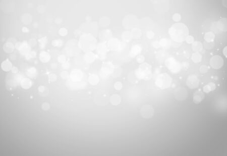 Grey sparkles glitter and rays lights bokeh abstract holiday backgroundtexture.