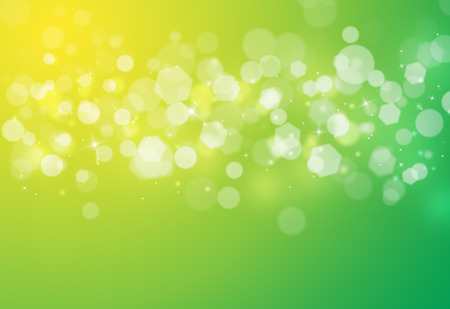 Green sparkles glitter and rays lights bokeh abstract holiday backgroundtexture.