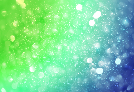 Green and Blue sparkle rays lights with bokeh elegant abstract background. Dust sparks in explosion background. Vintage or retro. Imagens
