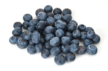 A small pile of blueberries on white background Standard-Bild