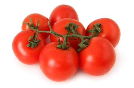 Seven red vine tomatoes on white background
