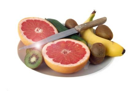 Obstschale mit Früchten und einem Messer Lizenzfreie Bilder