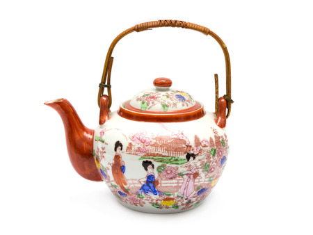 A teapot with Asian painting