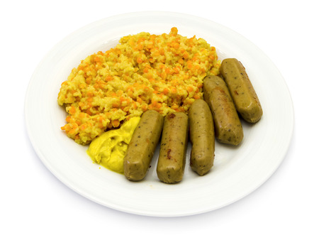 Couscous with red lentils and sausages on a white plate