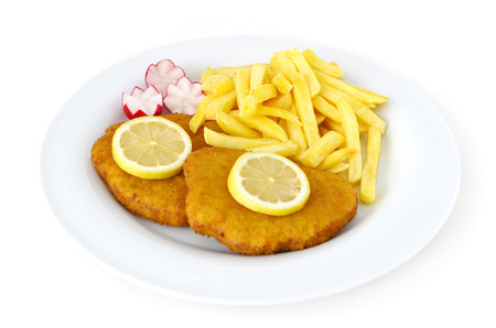 Schnitzel with french fries on white plate