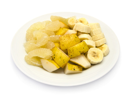 Fruit plate with bananas, sweetie  oroblanco , yellow pear  williams  on white background