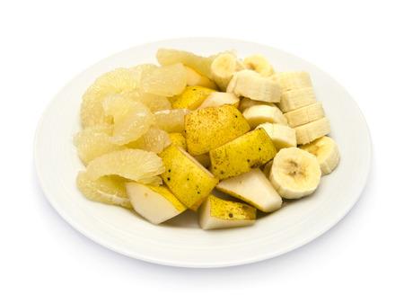 Obstteller mit Bananen, Süße oroblanco, gelbe Birne williams auf weißem Hintergrund