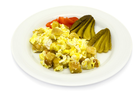 Bohemian dumplings  Knödel  with egg and pickled gherkins on a white plate Standard-Bild