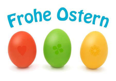 Frohe Ostern mit Ostereiern rot, grün und gelb Standard-Bild - 27362821