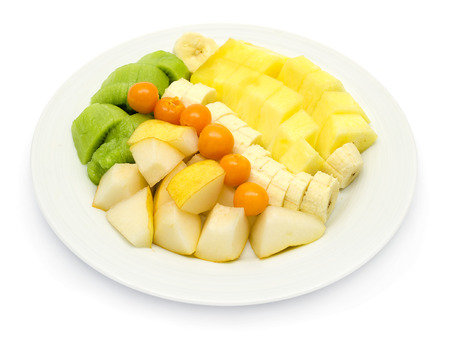 Fruit plate with bananas, pineapple, physalis, kiwi and yellow pear williams on white background