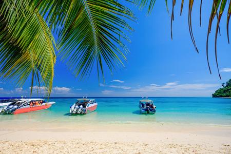 White Beach Blue Ocean and Blue Sky  at Rok Island Thailand Stock Photo