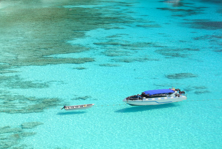 Boat on Blue Ocean Clear Water Stock Photo