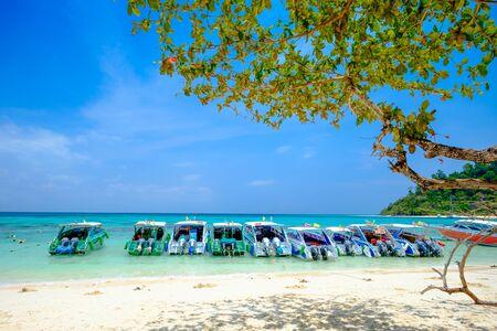Boat on White Beach Blue Ocean and Blue Sky  at Rok Island Thailand