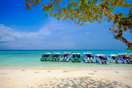 Boat White Beach Blue Ocean and Blue Sky  at Rok Island Thailand
