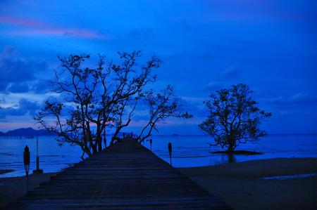 Wood Port and Sunset Blue Sky Twilight  on the beach