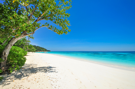 white Beach and Blue Ocean with  Blue Sky at Tachai Island Thailand Stock Photo