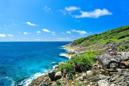 Rock Mountain with Blue Ocean on Blue Sky