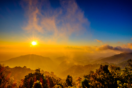 Sun Rise Flare and Mountain Viewpoint Stock Photo