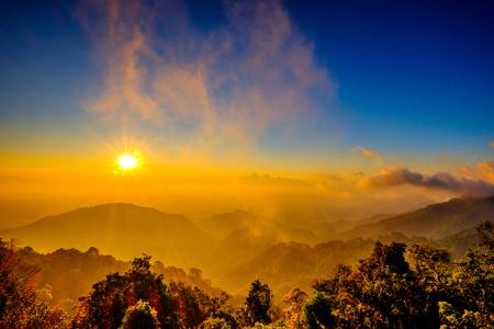 sun rise: Sun Rise Flare and Mountain Viewpoint Stock Photo