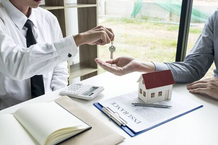 Accountants are checking the homeowner's finances to ensure there is a deposit. Stock Photo