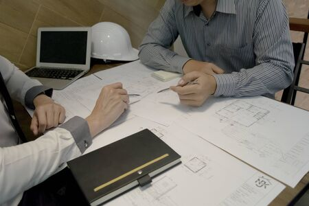 A young man, an engineer, had a meeting to prepare the construction work.