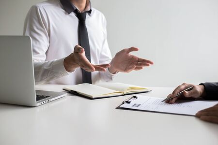Executives are interviewing job applicants and preliminary background checks, candidates are talking about their past work experience, personal managers make hiring decisions.