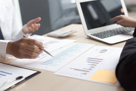 Financial and investment planning, Head of Marketing is analyzing data from the summary graph statistics for executives, business meetings. Archivio Fotografico