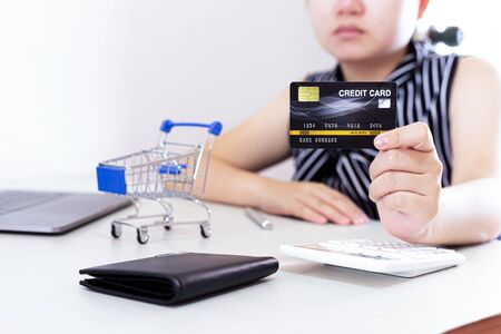 Close-up of young women using mobile phones and credit cards for online payments, Online shopping concept.