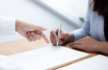 Business people negotiate for customers to sign land sales contracts, Property purchase contract of concept